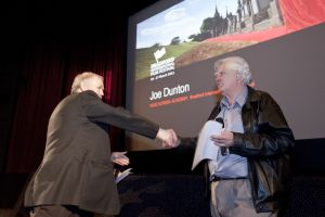 Film Festival March 26 2011 Bill Lawrence Pictureville awarding Joe Dunton sm.jpg